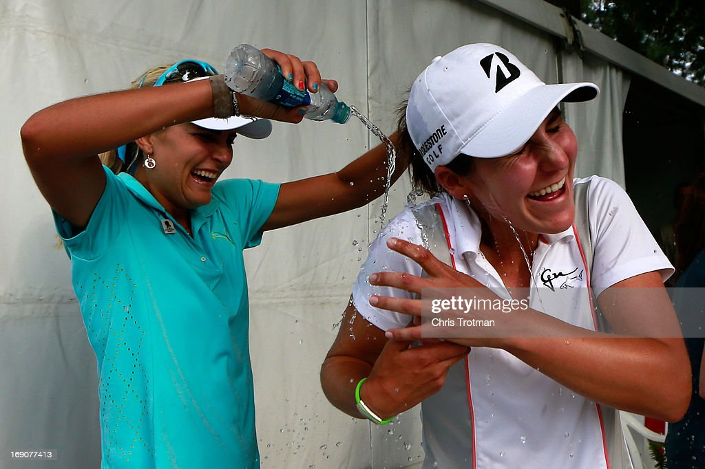 Lexi Thompson dunks water on (R) Jennifer Johnson following her first LPGA victory after the final round of the Mobile Bay LPGA Classic at the Crossings Course at the Robert Trent Jones Trail at Magnolia Grove on May 19, 2013 in Mobile, Alabama.