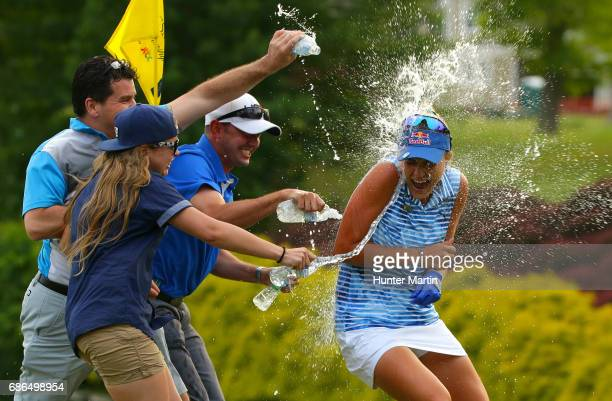 Lexi Thompson gets sprayed with water on the 18th green after winning the Kingsmill Championship presented by JTBC on the River Course at Kingsmill...
