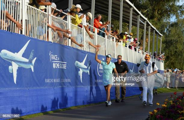 Lexi Thompson high fives the crowd as she walks to the 18th green during the final round of the ANA Inspiration on the Dinah Shore Tournament Course...