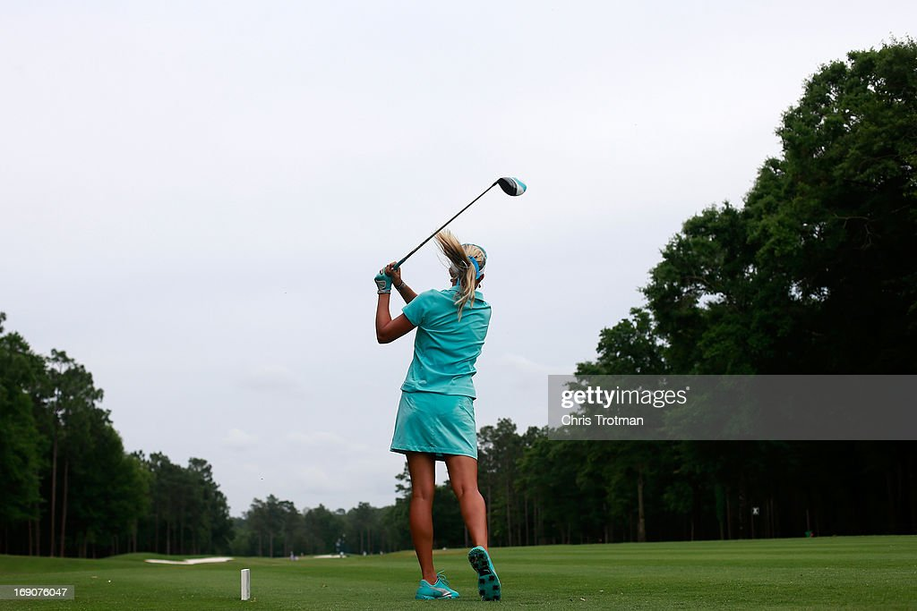 Lexi Thompson hits her tee shot on the 13th hole during the final round of the Mobile Bay LPGA Classic at the Crossings Course at the Robert Trent Jones Trail at Magnolia Grove on May 19, 2013 in Mobile, Alabama.