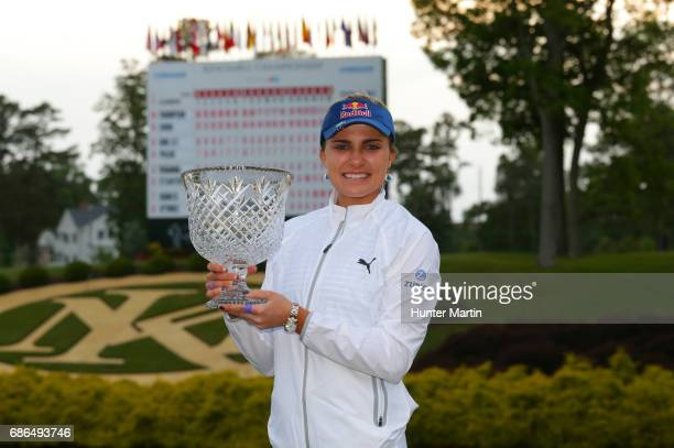 Lexi Thompson holds the championship trophy after winning the Kingsmill Championship presented by JTBC on the River Course at Kingsmill Resort on May...