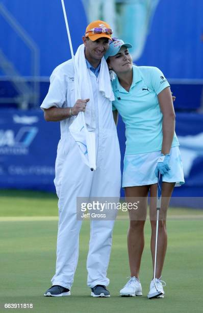 Lexi Thompson hugs her caddie Kevin Mcalpine on 18th green following the final round of the ANA Inspiration at the Dinah Shore Tournament Course at...
