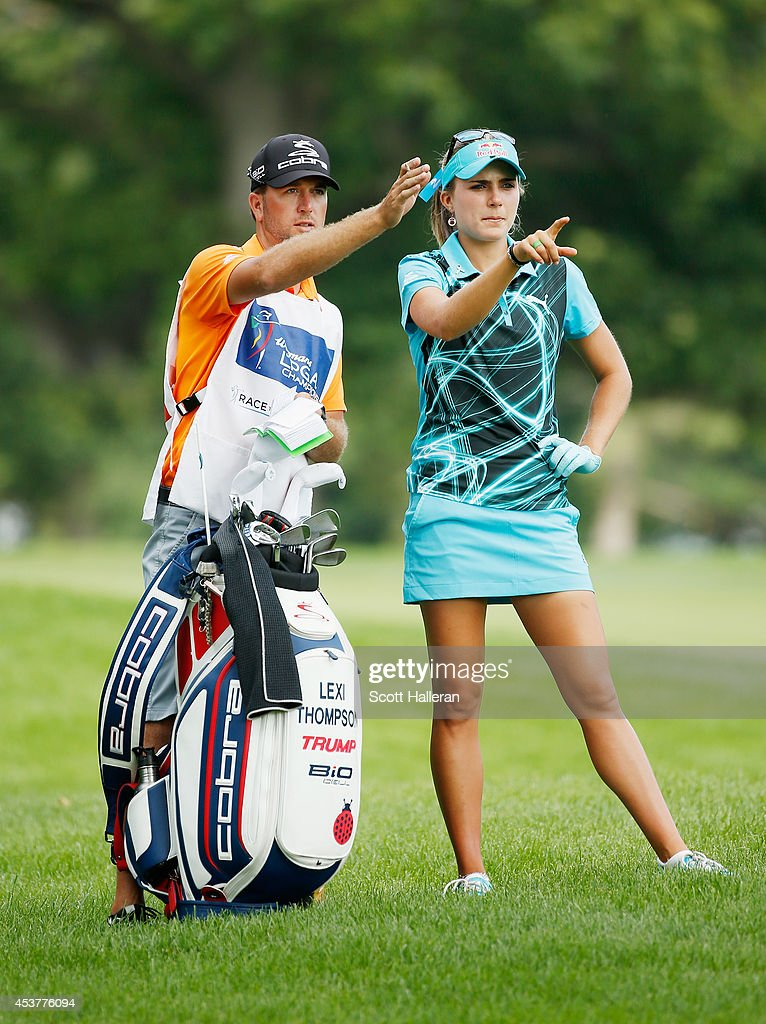 Lexi Thompson lines up a shot with her caddie during the final round of the Wegmans LPGA Championship at Monroe Golf Club on August 17, 2014 in Pittsford, New York.