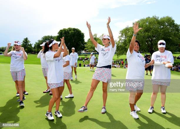 Lexi Thompson of Team USA celebrates victory over Team Europe during the final day singles matches of the Solheim Cup at the Des Moines Golf and...