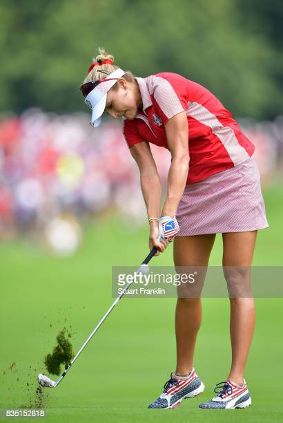 Lexi Thompson of Team USA plays a shot during the morning foursomes matches of The Solheim Cup at Des Moines Golf and Country Club on August 18 2017...