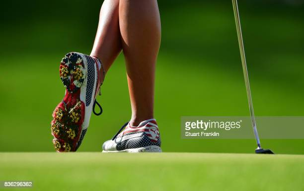 Lexi Thompson of Team USA wares her patriotic golf shoes during the final day singles matches of The Solheim Cup at Des Moines Golf and Country Club...