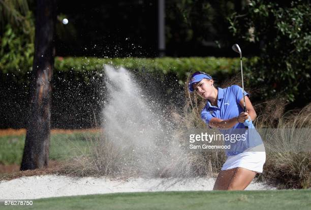 Lexi Thompson of the United States plays a shot from a bunker on the sixth hole during the final round of the CME Group Tour Championship at the...