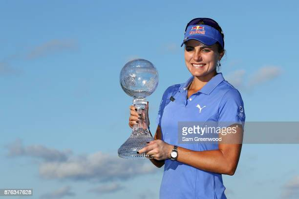 Lexi Thompson of the United States poses with the CME Race for the Globe trophy after the final round of the CME Group Tour Championship at the...