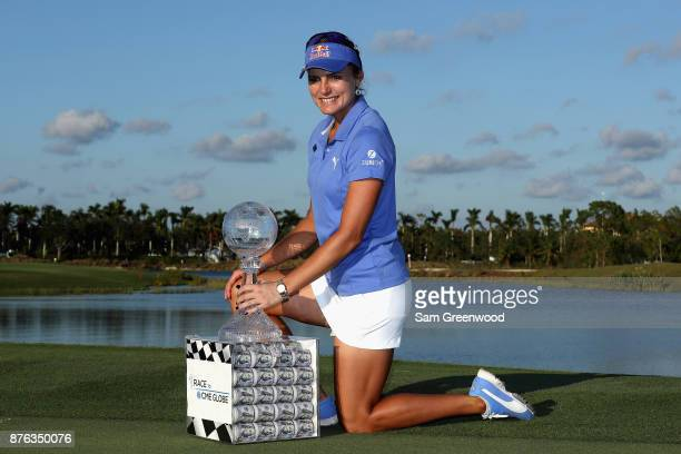 Lexi Thompson of the United States poses with the CME Race for the Globe trophy and a box containing one million dollars after the final round of the...