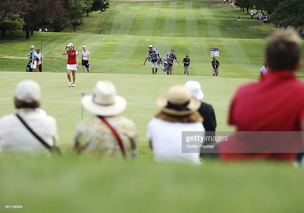 Lexi Thompson of the United States, So-Yeon Ryu of South Korea and Catriona Matthew of Scotland approach the 18th green during day two of the ISPS Handa Australian Open at Royal Canberra Golf Club on February 15, 2013 in Canberra, Australia.
