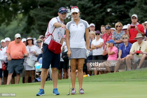 Lexi Thompson of the United States Team lines up a putt on the 14th hole in her match with Cristie Kerr against Jodi Ewart Shadoff and Caroline...