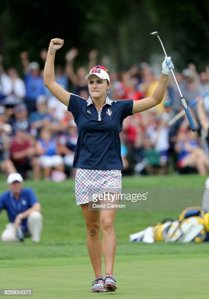 Lexi Thompson of the United States team plays her celebrates holing an eagle putt to win the 15th hole in her match against Anna Nordqvist of Sweden...
