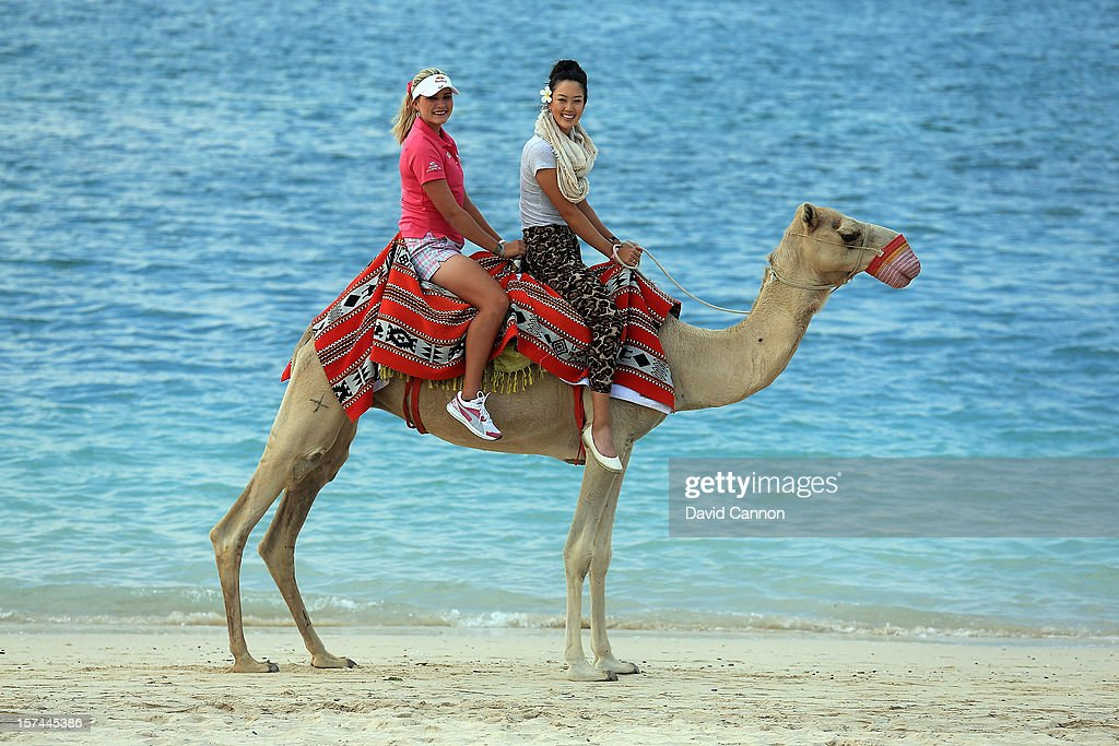 Lexi Thompson (l) of the USA and <a gi-track='captionPersonalityLinkClicked' href=/galleries/search?phrase=Michelle+Wie&family=editorial&specificpeople=201982 ng-click='$event.stopPropagation()'>Michelle Wie</a> of the USA riding a camel on the beach at the Jebel Ali Golf Resort and Spa as a preview for the 2012 Omega Dubai Ladies Masters on December 2, 2012 in Dubai, United Arab Emirates.