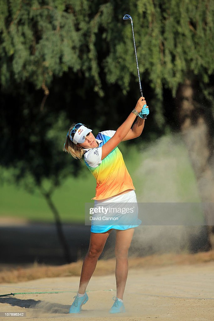 Lexi Thompson of the USA plays her second shot at the par 4, 14th hole during the third round of the 2012 Omega Dubai Ladies Masters on the Majilis Course at the Emirates Golf Club on December 7, 2012 in Dubai, United Arab Emirates.