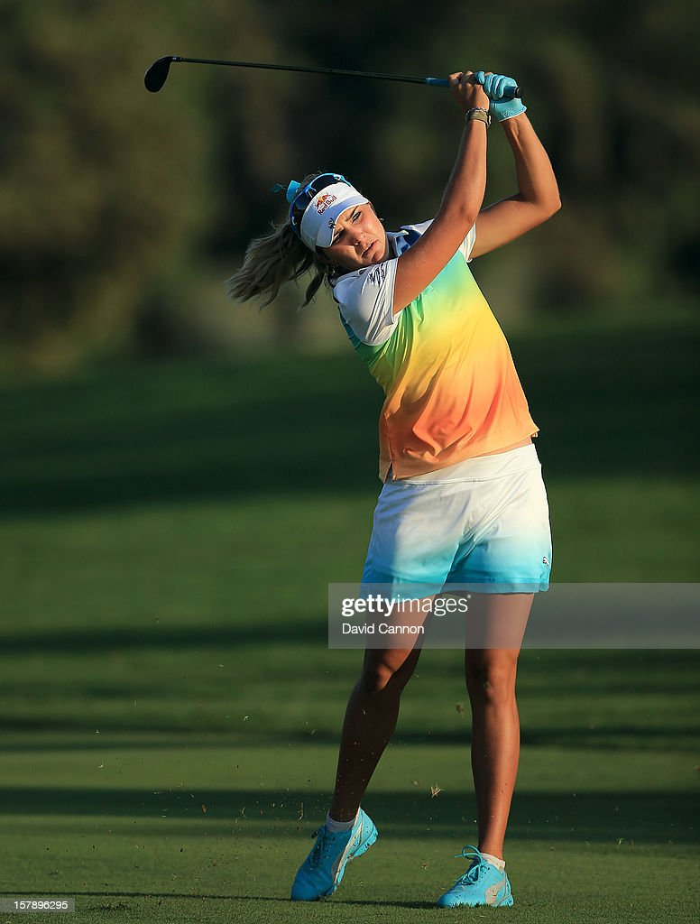 Lexi Thompson of the USA plays her second shot at the par 5, 18th hole during the third round of the 2012 Omega Dubai Ladies Masters on the Majilis Course at the Emirates Golf Club on December 7, 2012 in Dubai, United Arab Emirates.