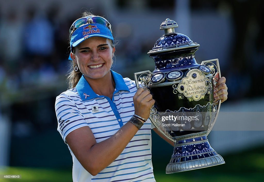Lexi Thompson of the USA poses with the winner's trophy after her one-stroke victory at the Lorena Ochoa Invitational Presented by Banamex at the Guadalajara Country Club on November 17, 2013 in Guadalajara, Mexico.