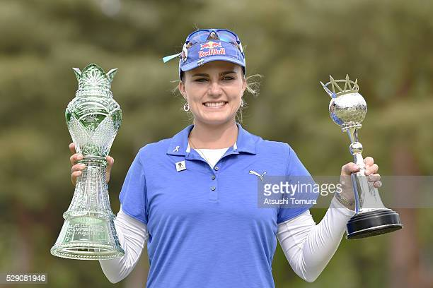 Lexi Thompson of the USA poses with trophies after winning the World Ladies Championship Salonpas Cup at the Ibaraki Golf Club on May 8 2016 in...