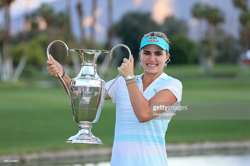 Lexi Thompson of the USA proudly holds the trophy after her three shot win during the final round of the 2014 Kraft Nabisco Championship on the Dinah Shore Tournament Course at Mission Hills Country Club on April 6, 2014 in Rancho Mirage, California.