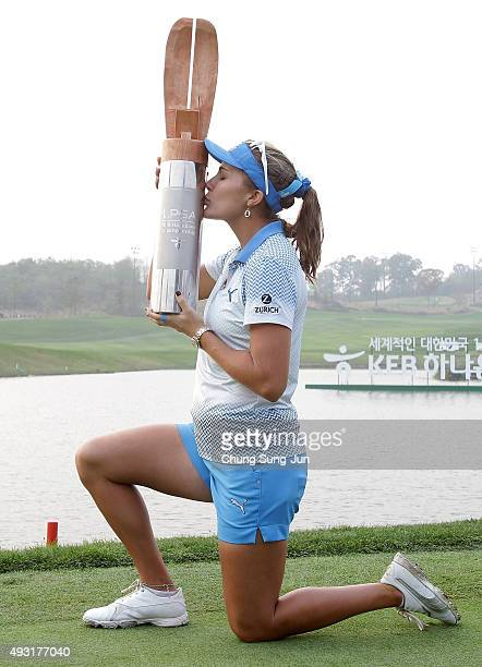 Lexi Thompson of United States kisses the winners trophy during a ceremony following the LPGA KEB HanaBank on October 18 2015 in Incheon South Korea
