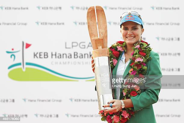 Lexi Thompson of United States lifts the winners trophy during a ceremony following the LPGA KEB HanaBank on October 18 2015 in Incheon South Korea