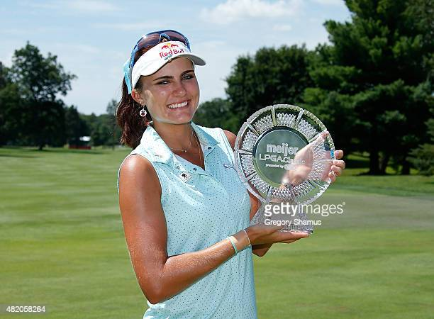 Lexi Thompson poses with the championship trophy after winning the Meijer LPGA Classic presented by Kraft at Blythefield Country Club on July 26 2015...