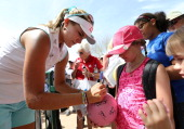 Lexi Thompson signs autographs for young fans following the first round of the JTBC LPGA Founders Cup at Wildfire Golf Club on March 20 2014 in...