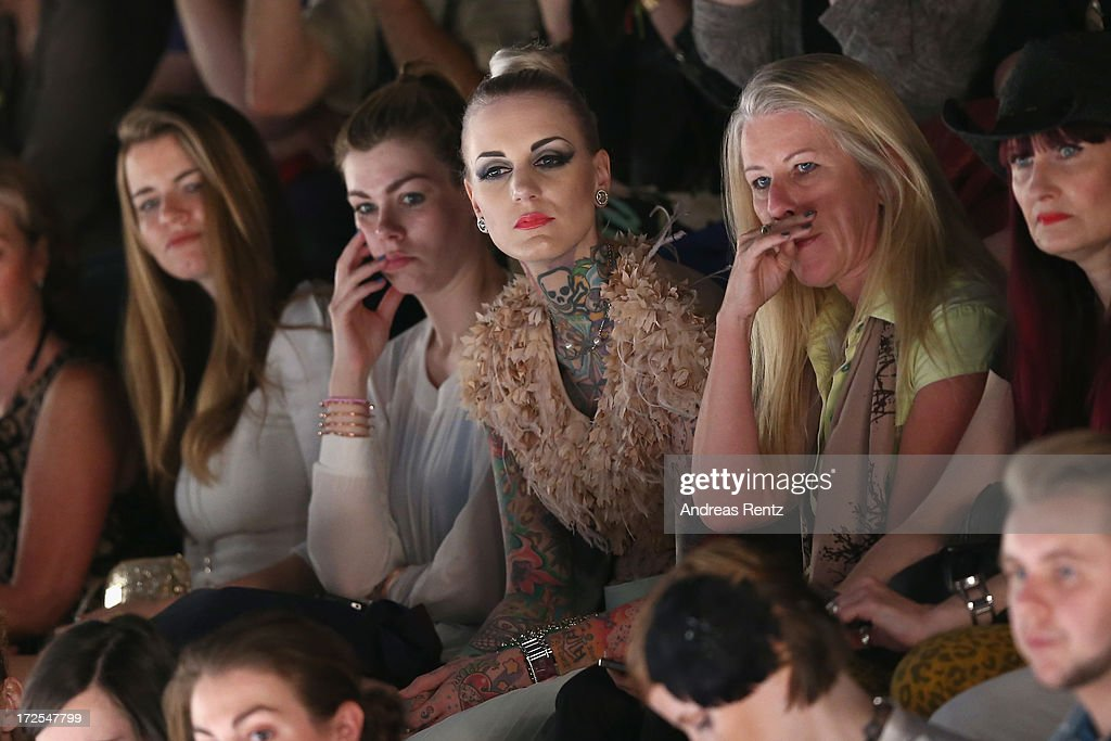 Lexie Hell (C) attends the Dimitri show during the Mercedes-Benz Fashion Week Spring/Summer 2014 at the Brandenburg Gate on July 3, 2013 in Berlin, Germany.