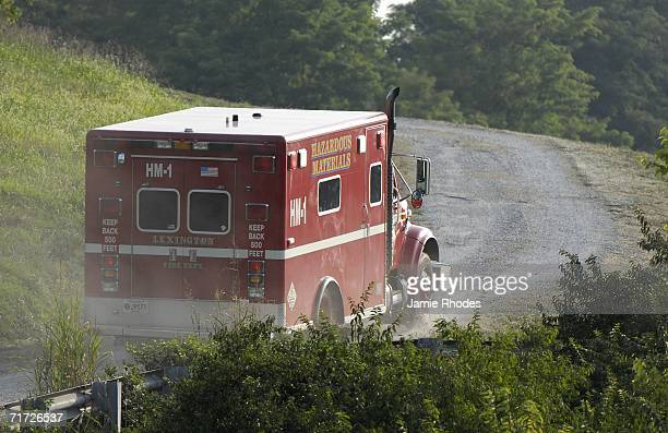 Lexington Fire Department hazardous materials truck drives up a gravel road to the scene where Comair Flight 5191 crashed shortly after departure...
