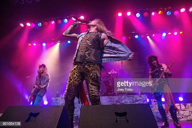 Lexxi Foxx Michael Starr Stix Zadinia and Satche of Steel Panther perform live onstage at Egyptian Room at Old National Centre on December 11 2015 in...