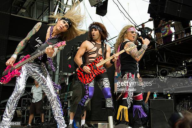 Lexxi Foxxx Michael Starr and Satchel of Steel Panther performs during 2013 Rock On The Range at Columbus Crew Stadium on May 19 2013 in Columbus Ohio