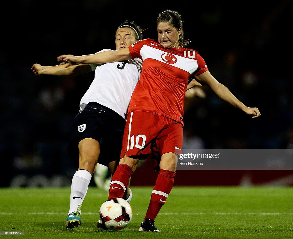 Leyla Gungor of Turkey holds off the challenge of Lucy Bronze of England during the FIFA Women's World Cup 2015 Group 6 qualifier between England and Turkey at Fratton Park on September 26, 2013 in Portsmouth, England.