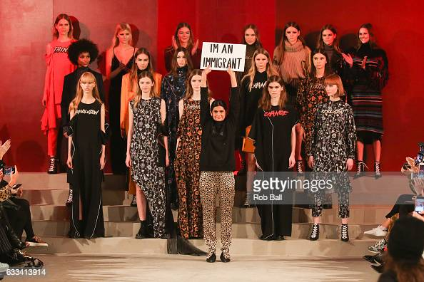 Leyla Piedayesh holds a sign saying 'I'm an Immigrant' at the end of her Lala Berlin show during the Copenhagen Fashion Week Autumn/Winter 17 on...