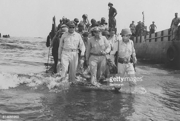 Gen Douglas MacArthur and his chief of staff Lt Gen Richard Sutherland wade through kneedeep water from landing craft at the start of the Leyte...