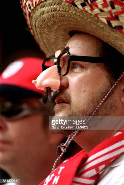 A Leyton Orient fan wearing a sombrero and a false nose glasses and moustache kit