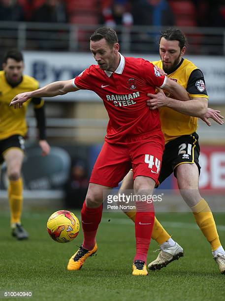 Leyton Orient player manager Kevin Nolan attempts to control the ball under pressure from JohnJoe O'Toole of Northampton Town during the Sky Bet...