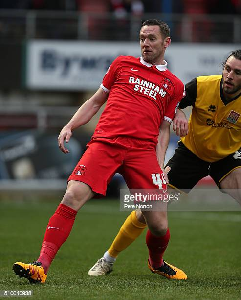 Leyton Orient player manager Kevin Nolan under pressure from JohnJoe O'Toole of Northampton Town during the Sky Bet League Two match between Leyton...