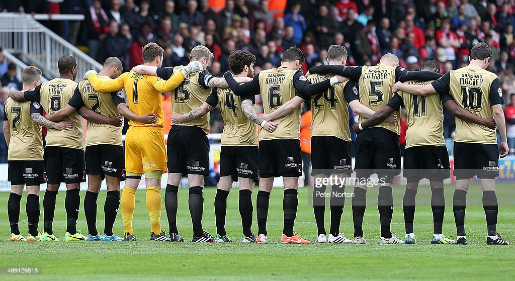 Leyton Orient players observe a minutes silence to mark the 29th anniversary of the Bradford Fire prior to the Sky Bet League One Semi Final First Leg between Peterborough United and Leyton Orient at London Road Stadium on May 10, 2014 in Peterborough, England.