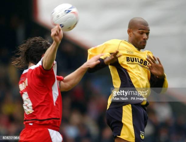 Leyton Orient's John Mackie and Oxford United's Eric Sabin battle for the ball during the CocaCola League Two match at Brisbane Road London Saturday...