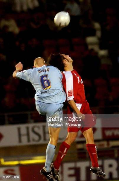 Leyton Orient's John Mackie battles with Chesterfield's Derek Niven during the FA Challenge Cup First Round match at Brisbane Road London Saturday...