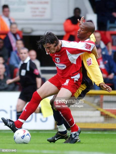 Leyton Orient's John Mackie battles with Oxford United's Eric Sabin during the CocaCola League Two match at Brisbane Road London Saturday October 29...