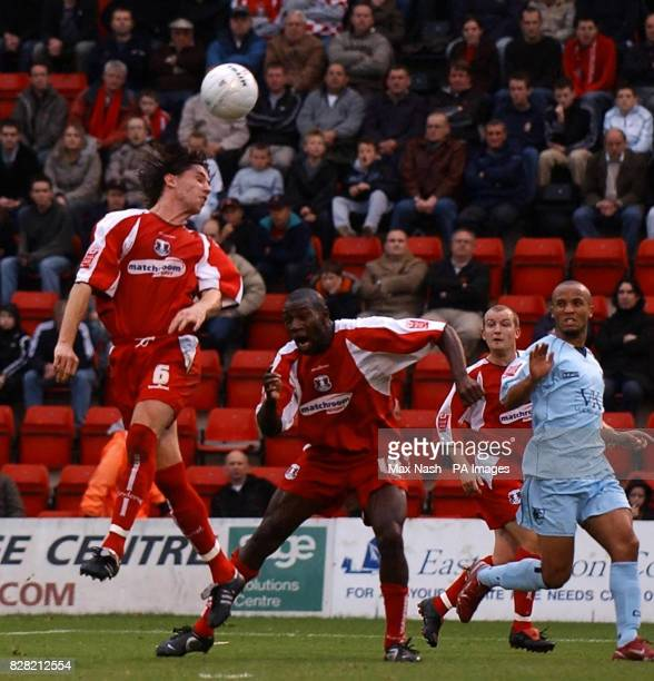 Leyton Orient's John Mackie rises above the Chesterfield defence during the FA Challenge Cup First Round match at Brisbane Road London Saturday...