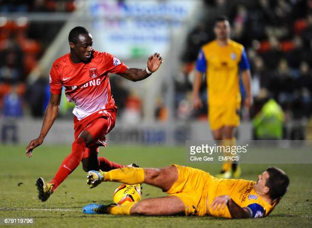Leyton Orient's Moses Odubajo and Preston North End's John Welsh battle for the ball during the Sky Bet Football League One match at the Matchroom...