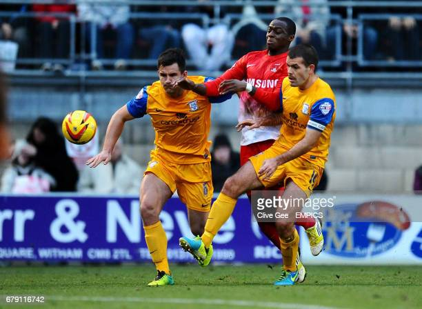 Leyton Orient's Moses Odubajo is muscled off the ball by Preston North End's Bailey Wright and Preston North End's John Welsh during the Sky Bet...