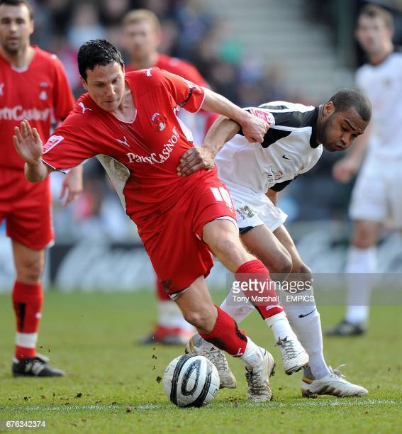 Leyton Orient's Sean Thornton and Milton Keynes Dons' Jermaine Easter battle for the ball