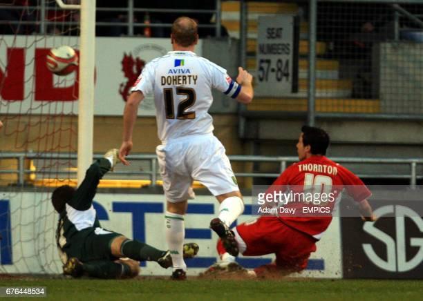 Leyton Orient's Sean Thornton scores the opening goal