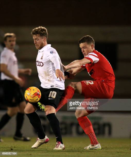 Leyton Orient's Shane Lowry battle for the ball with Bradford City's Billy Clarke