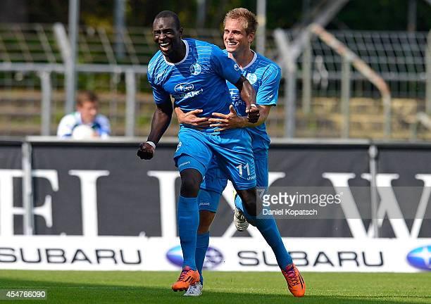 Lhadji Badiane of Stuttgart celebrates his team's second goal with team mate Fabian Gerster during the third Bundesliga match between Stuttgarter...