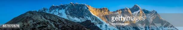 Lhotse 8516m Nuptse 7861m golden dawn Himalaya mountains panorama Nepal