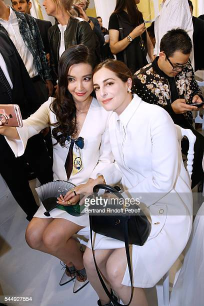 Li Bing Bing and Amira Casar attend the Christian Dior Haute Couture Fall/Winter 20162017 show as part of Paris Fashion Week on July 4 2016 in Paris...