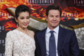 Li Bingbing and Mark Wahlberg attend the 'Transformers Age of Extinction' Berlin Premiere on June 29 2014 in Berlin Germany